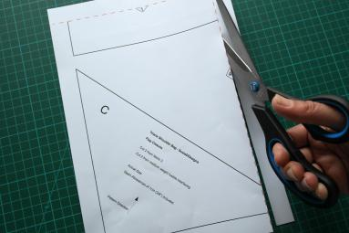 Cut along the dashed lines to remove edges of paper.