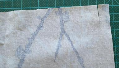 Cut the edge of material by about 2cm to start of hem to be stitched