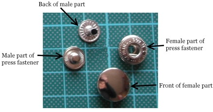 The four components that make up a riveted press snap fastener for craft ans sewing use.