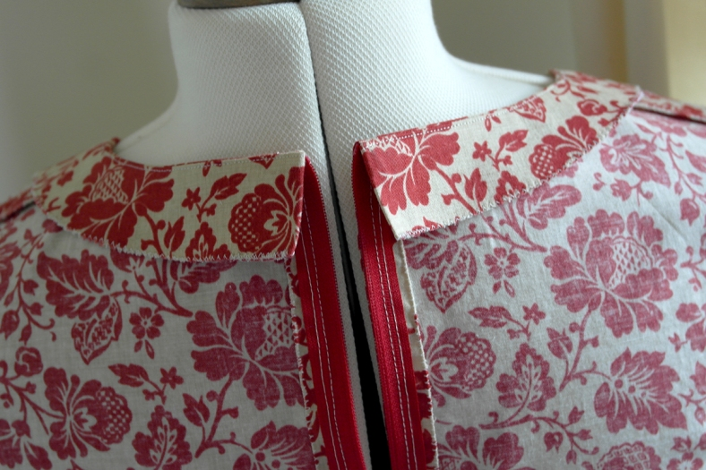 The neckline facing under stitched and finished