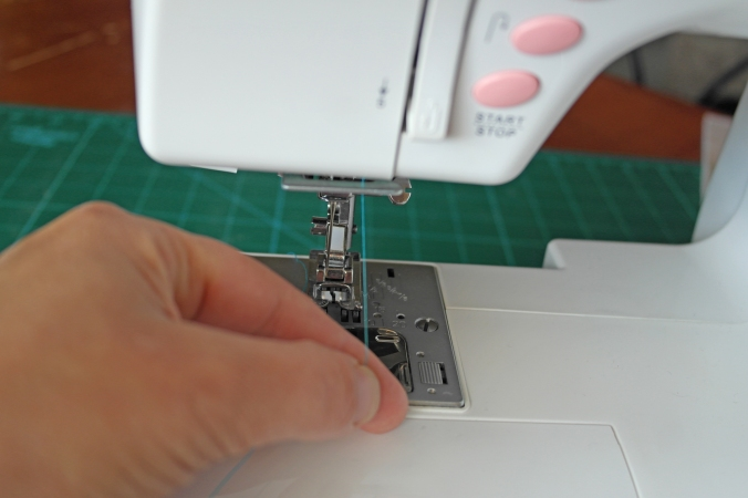 How to thread a sewing machine E