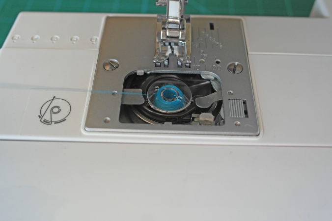 Threading a sewing machine 1